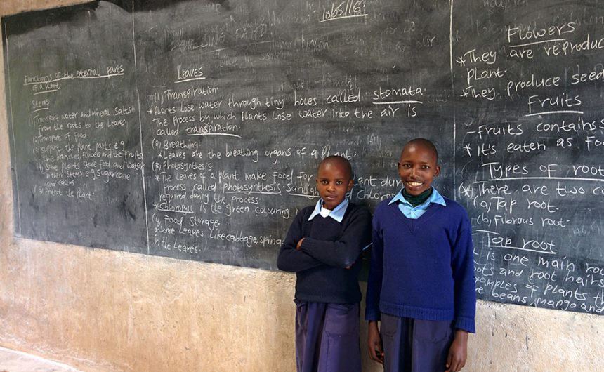 Students in front of the chalkboard