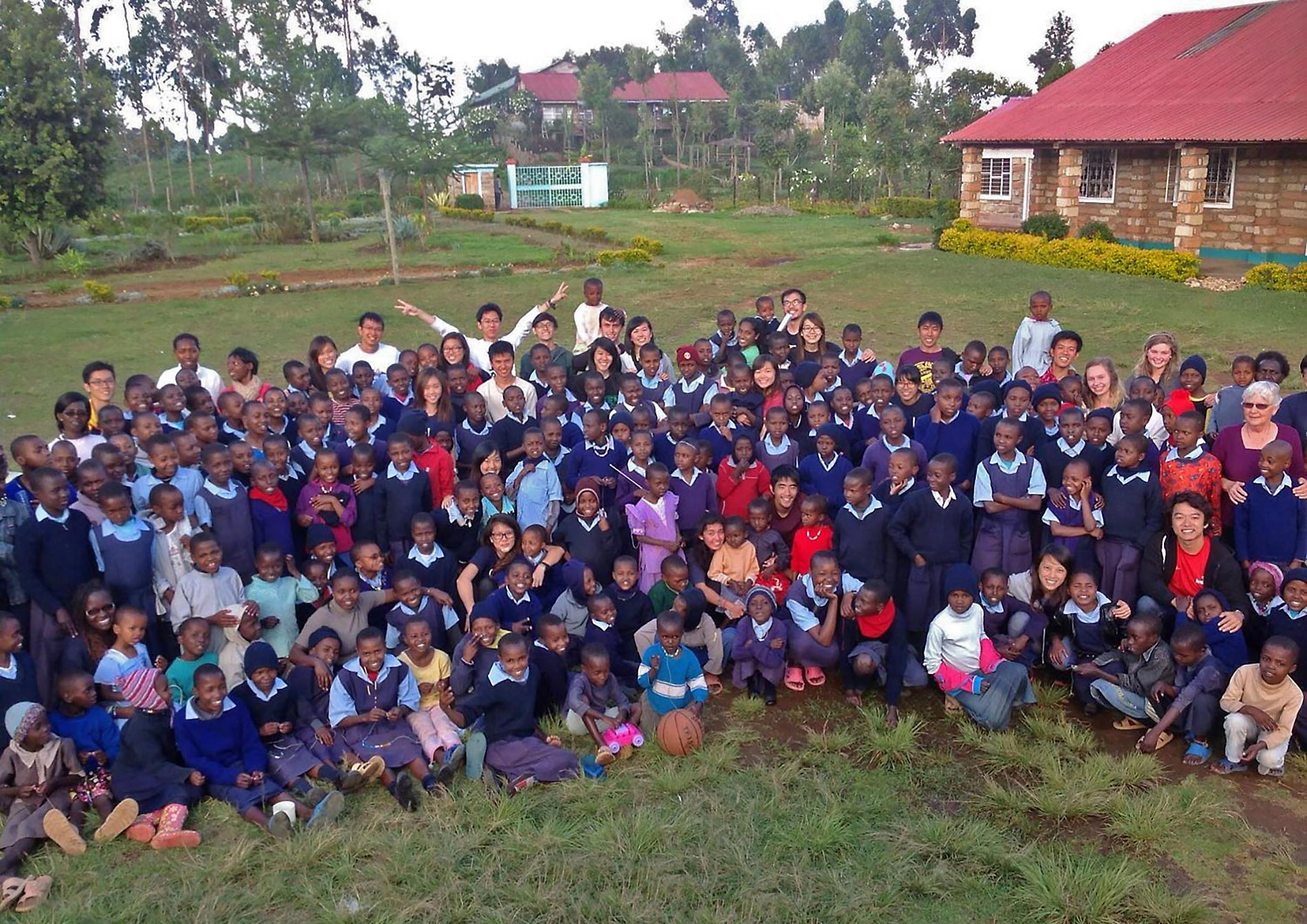 Our Lady of Grace Children's Home & School - students and volunteers