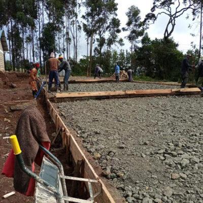 Men framing the base for the kindergarten