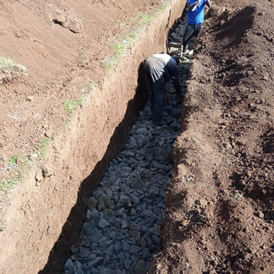 Men digging a trench for the new kindergarten school block with Action for God's Love