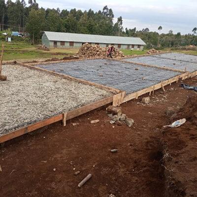 Cement & Rebar flooring for the new school. Original kindergarten only has dirt floors.