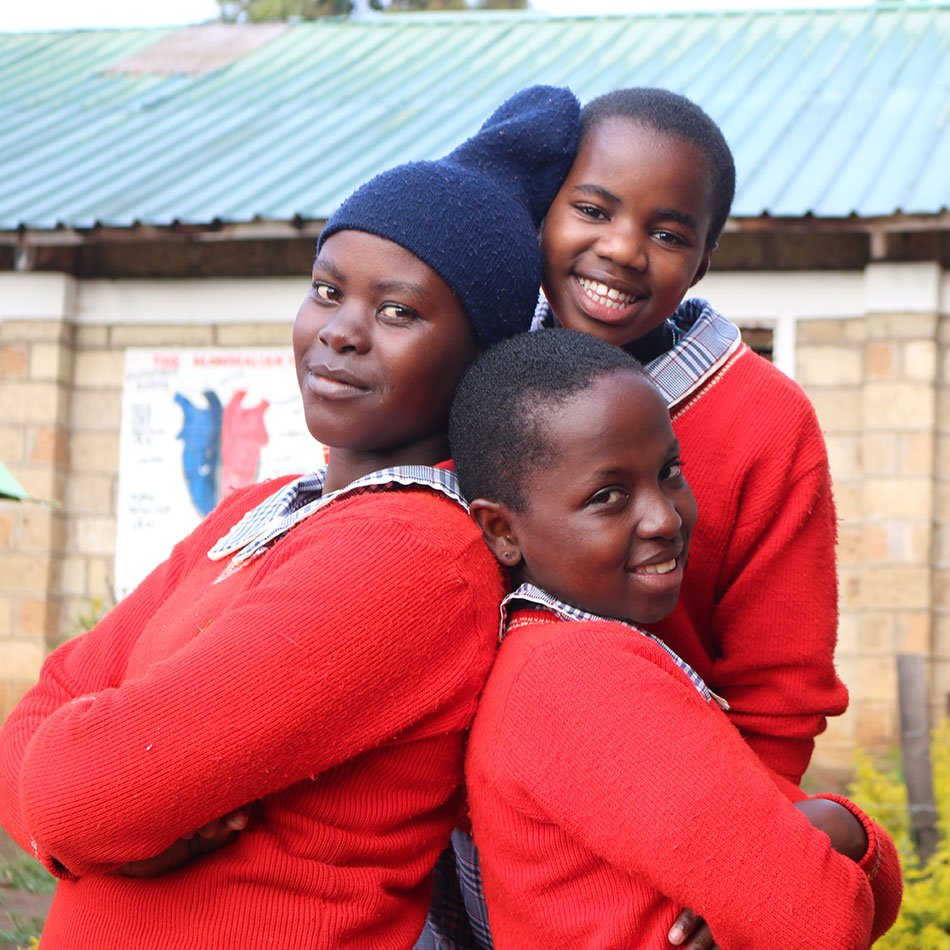 Three older students smiling