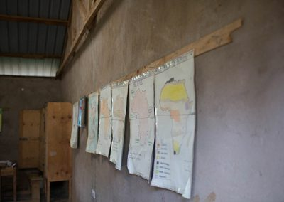Maps of Africa on the wall inside a classroom at OLOG School Kenya