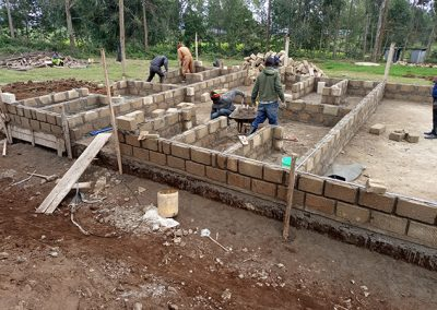 Cinder block walls being constructed on a new Kindergarten complex for Our Lady of Grace School Kenya