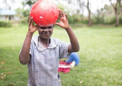 OLOG Student playing with a ball
