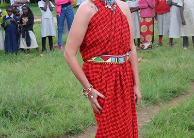 Volunteer Ashley Green wearing traditional dress and jewelry in celebration of International Women's Day 2020